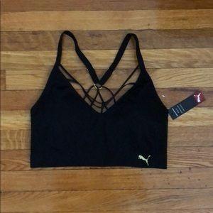 Black Puma sports bra with gold logo
